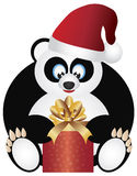 Panda Sitting with Santa Hat Opening Present Royalty Free Stock Photos