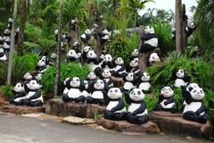 Panda statue in palm garden Stock Photos