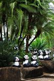 Panda statue in palm garden Royalty Free Stock Images