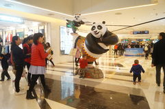Panda statue in shopping mall. Panda statue in shopping plaza, people and it took photos, in Shenzhen, china Stock Photography