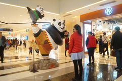 Panda statue in shopping mall. Panda statue in shopping plaza, people and it took photos, in Shenzhen, china Royalty Free Stock Photo