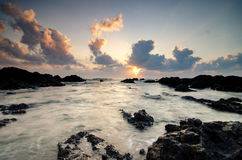 Pandak beach Located in Terengganu,Malaysia during sunrise with waves flowing over the rocks Stock Photos