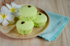 Pandan cake on wood table Royalty Free Stock Images