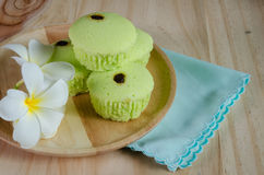 Pandan cake on wood table Stock Photos