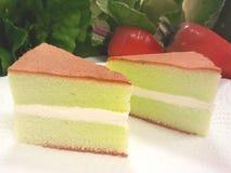 Pandan Chiffon Cake. Green chiffon cake on a leaf Royalty Free Stock Photography