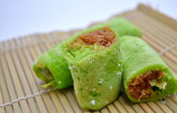 Pandan Pancakes with Coconut Flake. Peranakan Nonya Pandan Pancakes Stuffed with Sweetened Coconut Flakes Royalty Free Stock Image