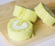 Pandan roll cake on wood Royalty Free Stock Photos