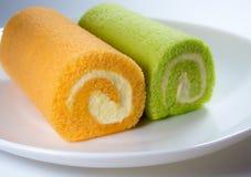 Pandan smak i Pomarańczowy smak rolki tort zdjęcie royalty free