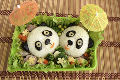 Pandas it is made of rice. Pandas are made of rice. Creative food for good mood and appetite Royalty Free Stock Photography