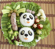Pandas are made of rice. Creative food for good mood and appetite Royalty Free Stock Photography
