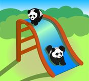 Pandas on a slide Royalty Free Stock Images
