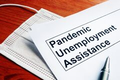 Free Pandemic Unemployment Assistance PUA And Medical Mask Stock Image - 182457521