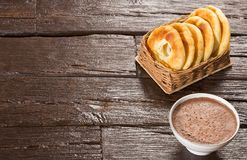 Pandequeso traditional Colombian food - Hot drink chocolate. Wood background stock images