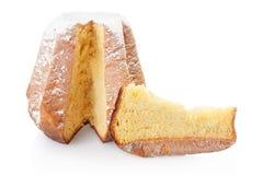 Pandoro,圣诞节蛋糕和部分在白色 免版税库存图片