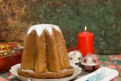 Pandoro - Italian xmas cake. Traditional Italian Christmas cake Pandoro with xmas candle and gifts Stock Photos