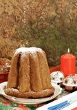 Pandoro - Italian xmas cake. Traditional Italian Christmas cake Pandoro with xmas candle and gifts Stock Photo