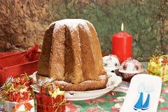 Pandoro - Italian xmas cake. Traditional Italian Christmas cake Pandoro with xmas candle and gifts Royalty Free Stock Photography