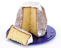 Pandoro with slice on blue plate Stock Image