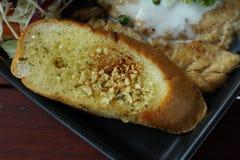 Pane all'aglio sulla ricetta della bistecca Fotografia Stock