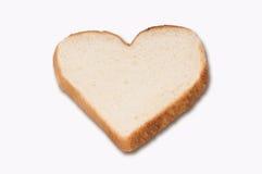 Pane bianco in una figura del cuore fotografie stock libere da diritti