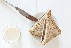 Pane con cioccolato e latte Fotografia Stock