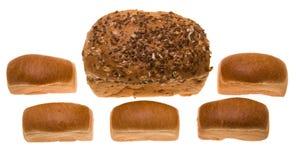Pane con i semi e cinque panini Fotografia Stock Libera da Diritti