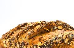Pane con i semi su priorità bassa bianca Fotografia Stock Libera da Diritti