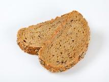 Pane con il papavero, il girasole ed i semi di sesamo Immagini Stock