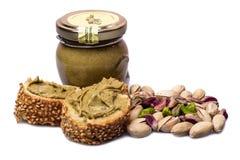Pane con la crema del pistacchio isolata Fotografie Stock