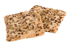 Pane croccante con i semi del girasole, del lino e dei semi di sesamo su fondo bianco Immagine Stock Libera da Diritti
