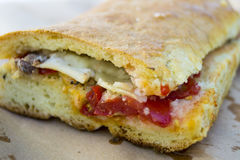 Pane cunzato. Traditional street food of Sicily, Italy. Pane cunzato: a white bread sandwich filled with tomato, pecorino cheese, anchovies, oregano and olive stock photography