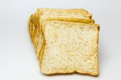 Pane del grano intero su priorità bassa bianca Fotografia Stock Libera da Diritti