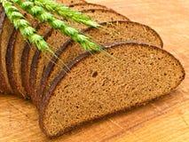 Pane e granulo alla scheda di legno Fotografia Stock