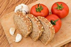 Pane e pomodori di aglio Immagine Stock