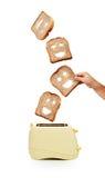 Pane e tostapane del pane tostato su bianco Fotografia Stock Libera da Diritti