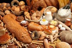 Pane, farina, latte, burro Fotografia Stock