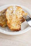 Pane inzuppato in latte/uova e zucchero e fritto in padella Fotografie Stock