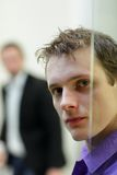 Pane,man's face portrait, another man in background Stock Photo