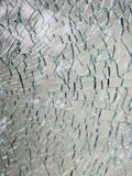 A pane of safety tempered glass shattered in many pieces. Broken Glass. A pane of safety tempered glass shattered in many pieces Stock Photo