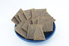 Pane secco del lino sul piatto blu Fotografia Stock Libera da Diritti
