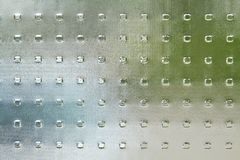 Pane. A textured colorful glass pane as a background stock images