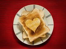 Pane tostato con amore Immagine Stock