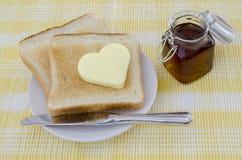 Pane tostato con burro Fotografia Stock