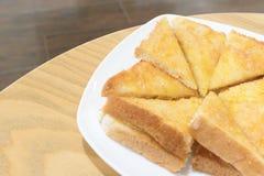 Pane tostato con burro e zucchero immagini stock libere da diritti
