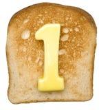 Pane tostato con il numero del burro Fotografia Stock Libera da Diritti
