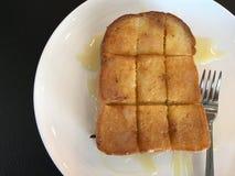 Pane tostato con latte condensato Immagine Stock