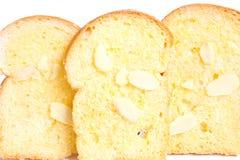 Pane tostato cotto del burro con le mandorle affettate Fotografia Stock