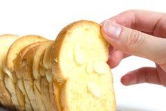 Pane tostato del burro cotto selezionamento con le mandorle affettate Fotografie Stock Libere da Diritti