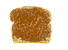 Pane tostato del grano intero con la diffusione della nocciola del cioccolato Fotografie Stock Libere da Diritti