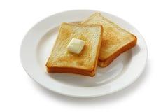 Pane tostato e burro Immagini Stock